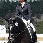 Regina Liberatore on Black Ice at Dressage Competition